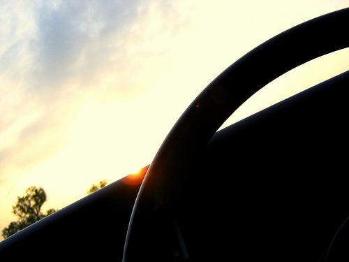 CC-licensed photo by flickr user Albowieb. A car's steering wheel against the light.