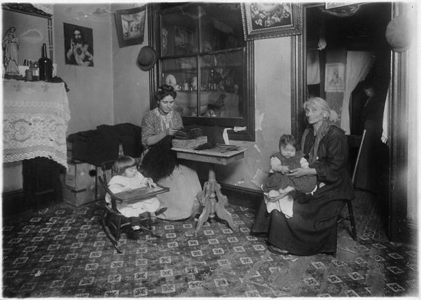 """Mrs. Larocca making willow plumes in an unlicenced tenement. Found nine families at work making feathers. When our investigator made her first call there she found the whole tenement in much worse condition. Children had bad skin trouble and fever, etc. New York City."" Photograph by Lewis Hine. Courtesy of Wikimedia and the National Archives and Records Administration."